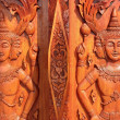 Native Thai style carving, painting on church door in the temple - Stock Photo