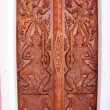 Native Thai style carving, painting on church door in the temple — Photo