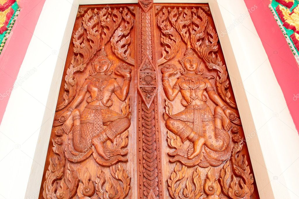 Native Thai style carving, painting on church door in the temple  Stock Photo #9796388