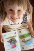 Happy girl reading book — Stock Photo