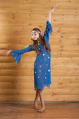 Girl dancing in blue dress — Stock Photo