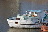 Motor boat at small river harbor — Stock Photo