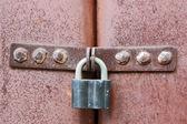 Rusty lock on garage gate — Foto Stock