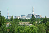 Lost city Pripyat and Chernobyl nuclear power station — Stock Photo