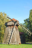 Antique wooden windmill — Stock fotografie