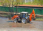 Tractor in a puddle — Stock Photo