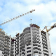 Crane and highrise construction site — Stock Photo