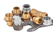 Plumbing pipe, valve and wrench — Stock Photo