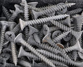 Dirty screw for plasterboard — Stock Photo