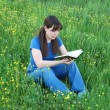 Girl reading at the meadow — Stock Photo #9556231