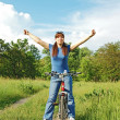 Girl on bike in field — Stock Photo