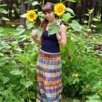 Girl between sunflower — Stock Photo #9558260
