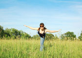 Fitness girl on field — Stock Photo