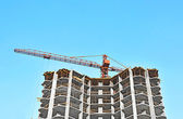 Crane and construction site — Stockfoto