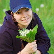 Girl with lily of the valley — Stock Photo #9749708
