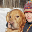 Portrait of the boy and golden retriever in the nature — Stock Photo #10047751