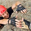 Climber Lending Helping Hand - Stock Photo