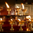 Royalty-Free Stock Photo: Burning candles in the Buddhist temple