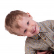 The little boy looks curiously — Stock Photo