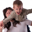 Son on his mother's shoulders having fun — Stock Photo #10310313
