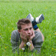 A young man lying in the meadow — Stock Photo