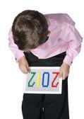 A little boy playing Mosaic — Stock Photo
