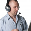A young man with headphones and a laptop — Stock Photo
