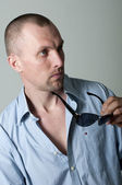 Serious young man in sunglasses in the studio — Stock Photo