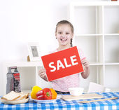 Girl holding sale sign — Stock Photo