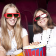 Girls in cinema — Stock Photo