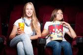Girls in cinema — Stock Photo