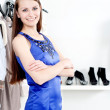 Young woman in mall buying clothes — Stock Photo #10389704