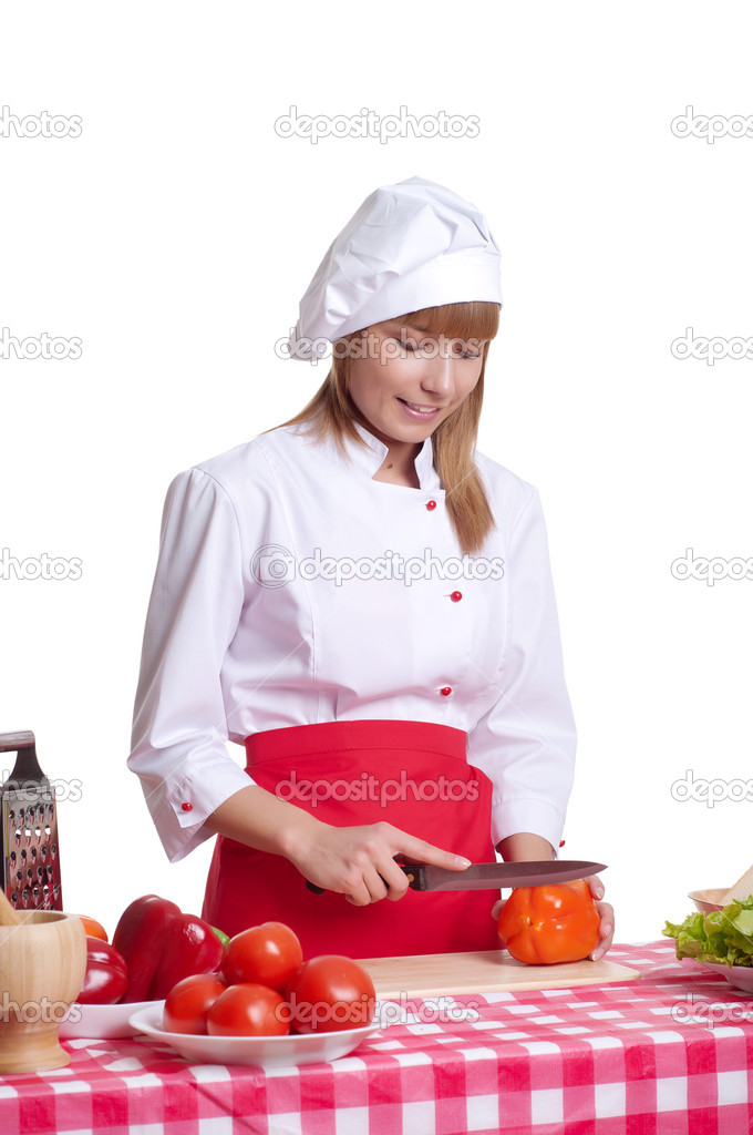 Attractive woman cuts vegetables, cooking dinner, white background  Stock Photo #10522509