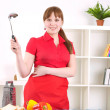 Woman working in the kitchen — Stockfoto