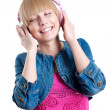 Stock Photo: Young attractive woman listing to music