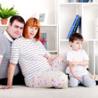 Pregnant mother, father and baby, home decor — Stockfoto