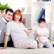 Pregnant mother, father and baby, home decor — Stock fotografie