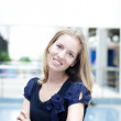 Beautiful woman in the trade center — Stock Photo