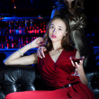 Young woman has a rest with an alcoholic drink — Stock Photo #8901392