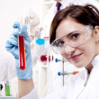 Portrait of a beautiful woman chemist — Stock Photo