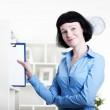 Woman puts a tablet with documents in a Shelfs — Stock Photo