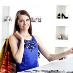Woman at shopping checkout paying credit card — Stock Photo #9155436