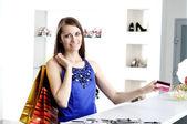 Woman at shopping checkout paying credit card — Stock Photo