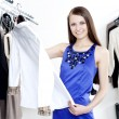 Young woman in mall buying clothes - Stock Photo