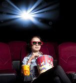Woman at the cinema — Stock Photo