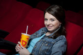 Woman in cinema — Stock Photo