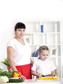 Mom and daughter cooking together — Stock Photo