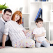 Pregnant mother, father and baby, home decor — Stock Photo