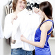 Cute man and the woman in shop choose clothes — Stock Photo