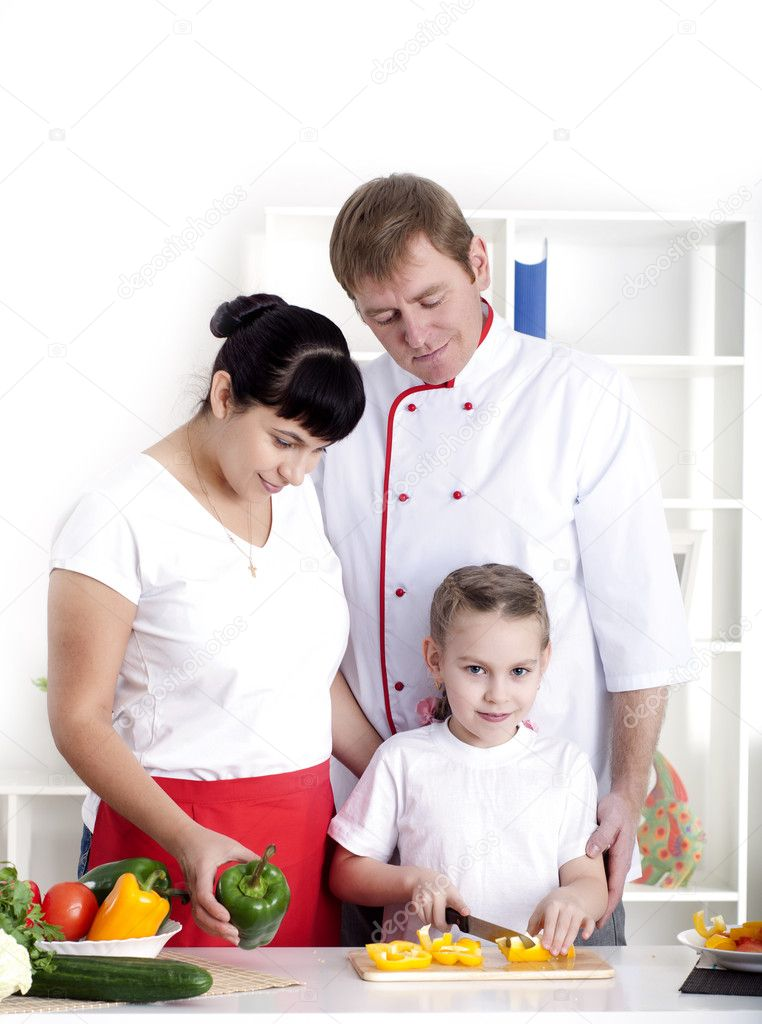 Portrait happy family is cooking dinner together — Stock Photo #9872194